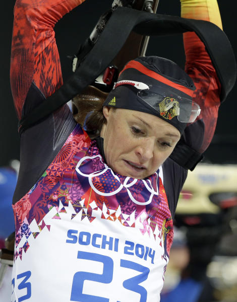 Germany's Evi Sachenbacher-Stehle holds his rifle during the women's biathlon 12.5k mass-start, at the 2014 Winter Olympics, Monday, Feb. 17, 2014, in Krasnaya Polyana, Russia. (AP Photo/Lee Jin-man)