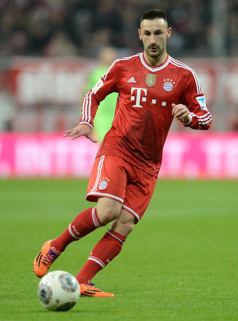 Bayern Munich's defender Diego Contento as he plays the ball on March 15, 2014