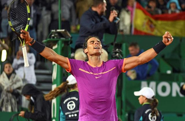 Spain's Rafael Nadal celebrates after winnining his match against Argentina's Diego Schwartzman during the Monte-Carlo ATP Masters Series Tournament tennis match, on April 21, 2017 in Monaco (AFP Photo/Yann COATSALIOU)