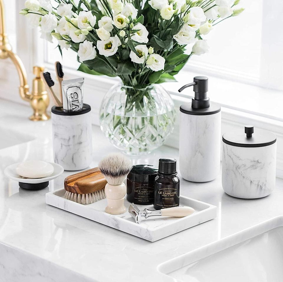 <p>We love when a bathroom essential like this <span>L'Mki Bathroom Soap Dispenser Set</span> ($52) doubles as chic decor. Whether you're a minimalist or you just love marble everything, this one's for you.</p>