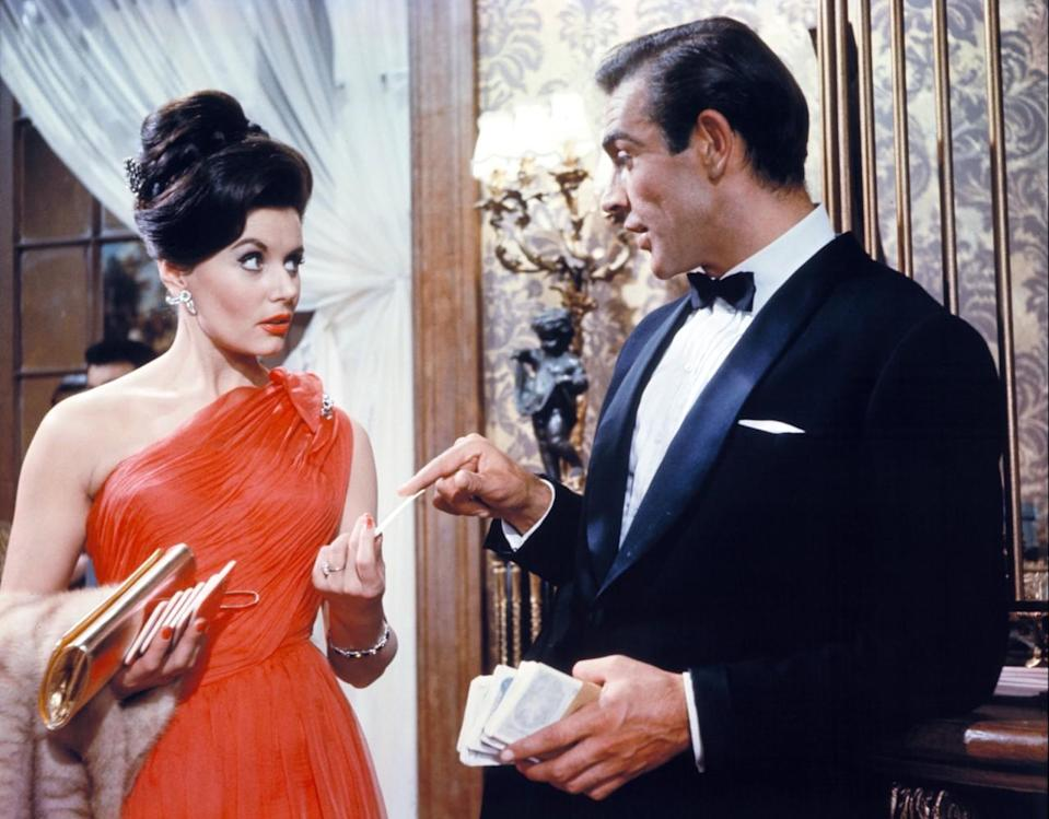 """<p>Officially the first female character to appear in the franchise, Trench meets Sean Connery as James Bond while playing Baccarat. It's then that he delivers his now-iconic introduction: """"Bond, James Bond."""" The stunning brunette was meant to be a recurring girlfriend in the films, but only made one other appearance in <i>From Russia with Love</i>. <i>(Photo: Everett Collection)</i></p>"""