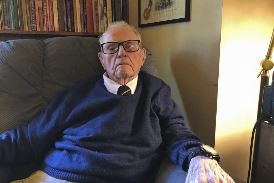 In this Oct. 19, 2018, photo, provided by John W. (Jack) Crawford III, retired Navy Capt. Jack Crawford poses for a photo at his home in Rockville, Maryland. Crawford, who recently turned 100 years old, served on the USS Yorktown during the World War II Battle of Midway and survived the Yorktown's sinking. (John W. (Jack) Crawford III via AP)