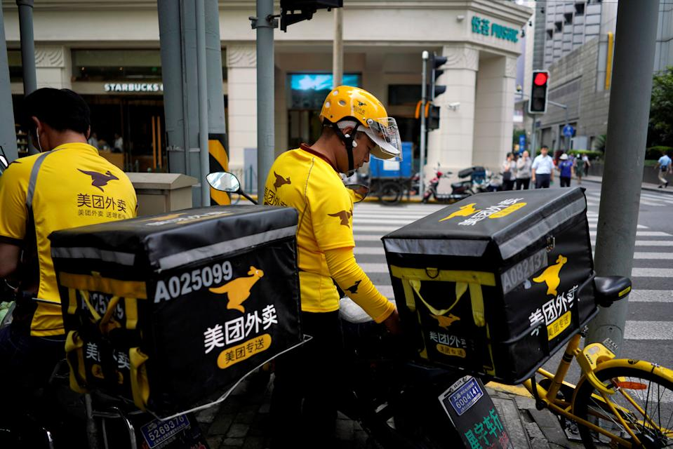 Drivers of food delivery service Meituan are seen in Shanghai, China June 25, 2018. REUTERS/Aly Song