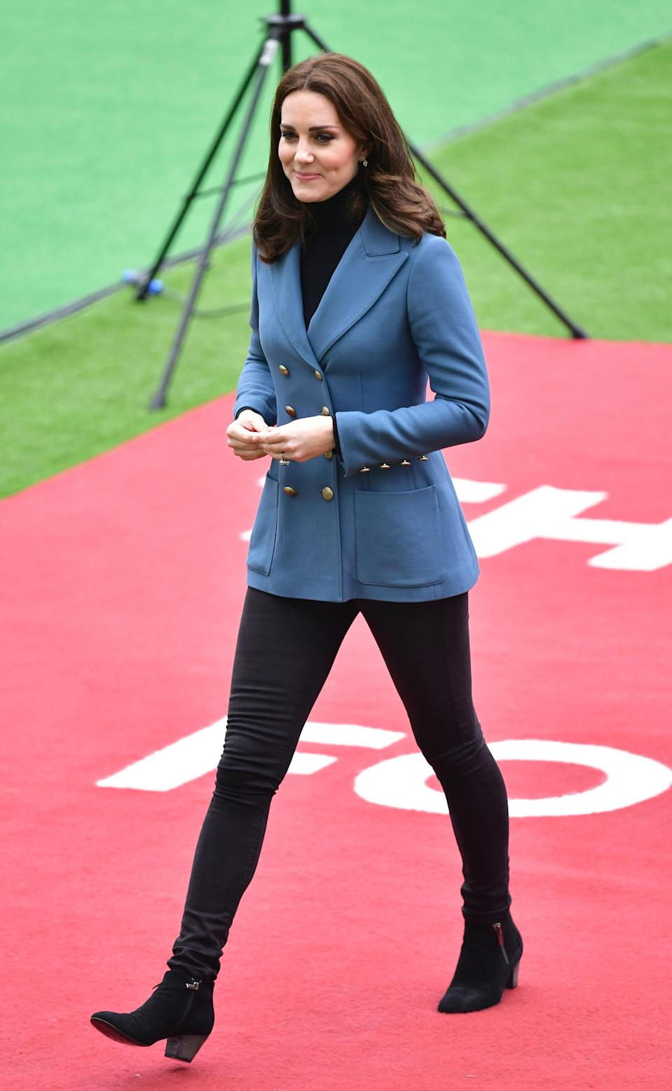 <p>Kate made another surprise visit to the Coach Core graduation ceremony, wearing a £900 blue blazer by Philosophy di Lorenzo Serafini, skinny black jeans and suede Russell and Bromley boots. If the Duchesses outfit looks recognisable, that's because she wore the red version of the jacket on Valentine's Day this year.<br><i>[Photo: PA]</i> </p>
