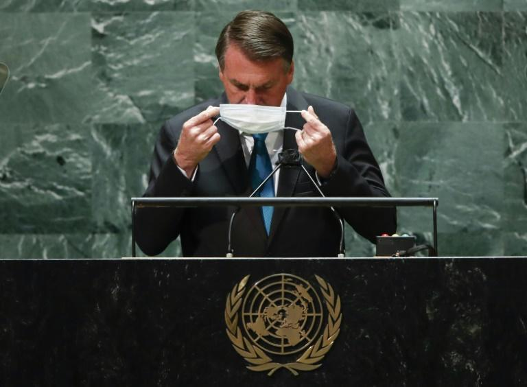 Brazil's President Jair Bolsonaro puts back on a protective facemask after he addresses the UN General Assembly (AFP/EDUARDO MUNOZ)