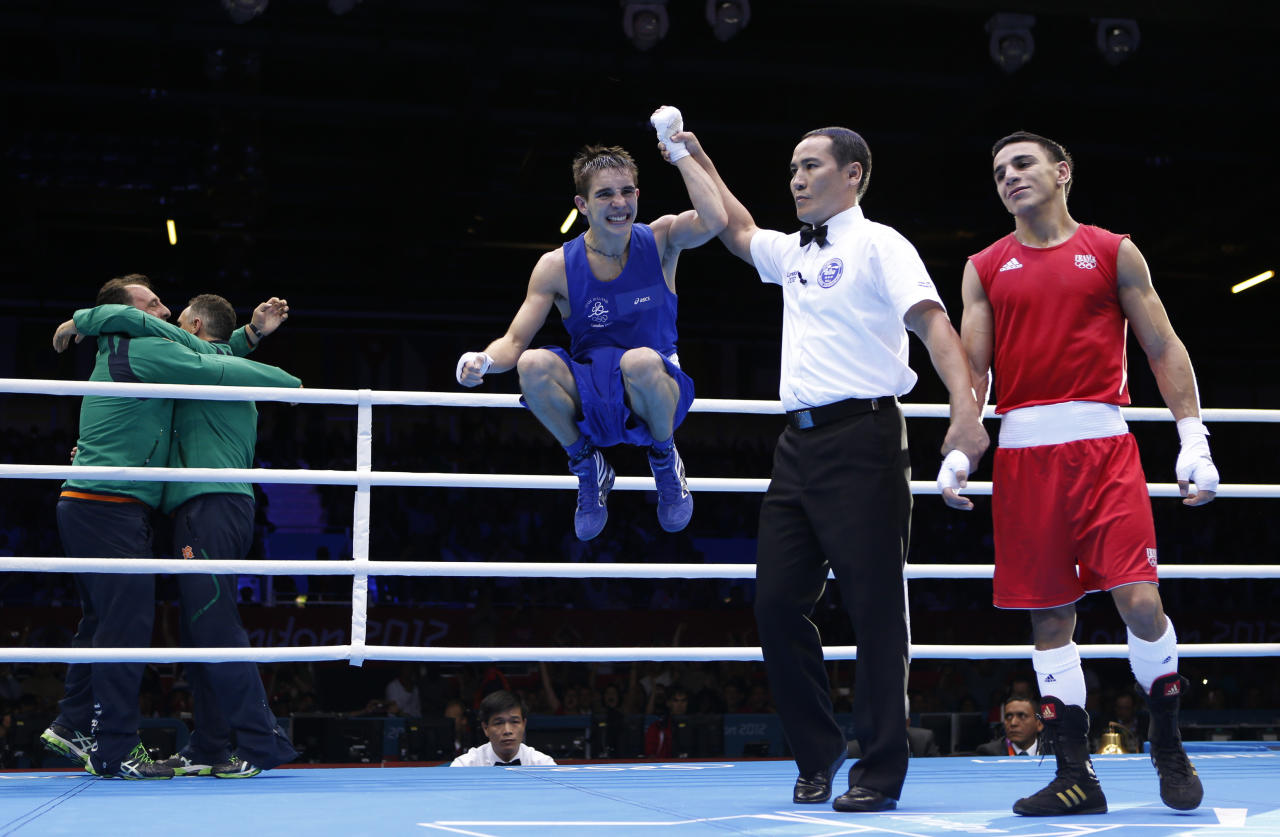 Ireland's Michael Conlan celebrates as he is declared the winner over France's Nordine Oubaali (R) after their Men's Fly (52kg) quarter-final boxing match at the London Olympic Games August 7, 2012.     REUTERS/Murad Sezer (BRITAIN  - Tags: SPORT BOXING OLYMPICS)