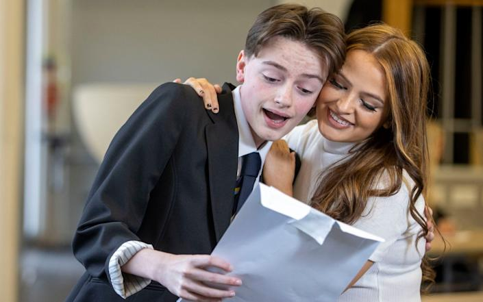 Dylan Quigley finding out his exam results with his sister Louise at Linwood High in Renfrewshire - Jeff Holmes /PA