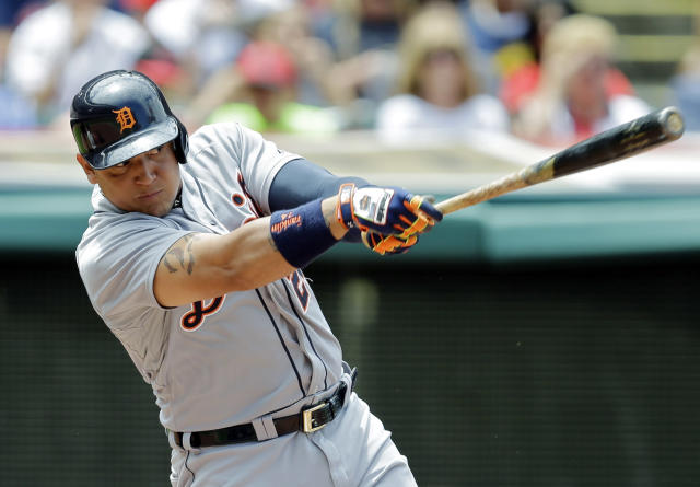 Detroit Tigers' Miguel Cabrera singles to drive in a run in the third inning of a baseball game against the Cleveland Indians, Sunday, June 22, 2014, in Cleveland. (AP Photo/Mark Duncan)