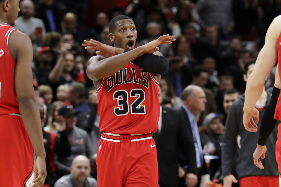 Chicago Bulls forward Kris Dunn reacts after guard Zach LaVine scored the game- winning score against the Los Angeles Clippers during the second half of an NBA basketball game Saturday, Dec. 14, 2019, in Chicago. The Bulls won 109-106. (AP Photo/Nam Y. Huh)