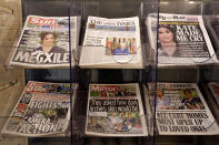 Newspapers are displayed for sale outside a shop in London, Monday, March 8, 2021. Britain's royal family is absorbing the tremors from a sensational television interview by Prince Harry and the Duchess of Sussex, in which the couple said they encountered racist attitudes and a lack of support that drove Meghan to thoughts of suicide. (AP Photo/Kirsty Wigglesworth)