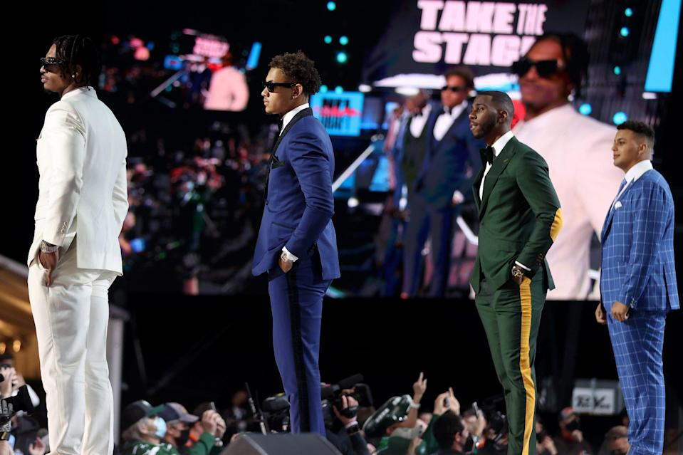 <p>Chase, Lance, Kyle Pitts and Rashawn Slater all stand onstage showing off their crisp suits for the occasion.</p>