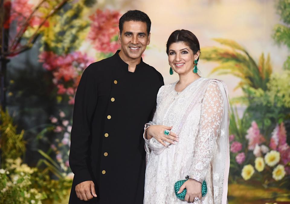 Indian Bollywood actors Akshay Kumar and his wife Twinkle Khanna pose for a picture during the wedding reception of actress Sonam Kapoor and businessman Anand Ahuja in Mumbai late on May 8, 2018. (Photo by Sujit Jaiswal / AFP)        (Photo credit should read SUJIT JAISWAL/AFP via Getty Images)