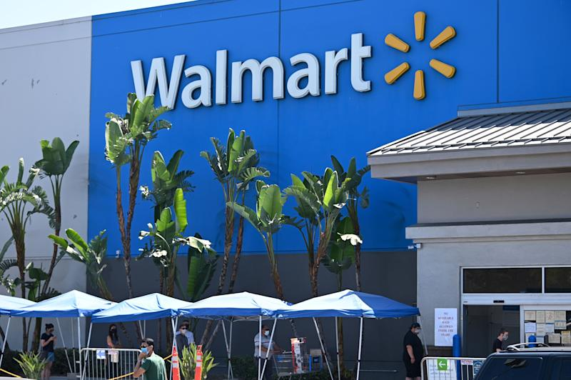 People wearing face coverings wait in line to shop at Walmart, July 22, 2020 in Burbank, California. - The country's most populous state reported a record 12,807 new coronavirus infections in the past 24 hours. (Photo by Robyn Beck / AFP) (Photo by ROBYN BECK/AFP via Getty Images)
