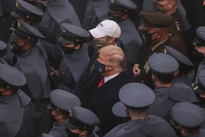 President Donald Trump looks on with West Point cadets during the first half against the Navy Midshipmen at Michie Stadium in West Point, New York, Dec. 12, 2020.