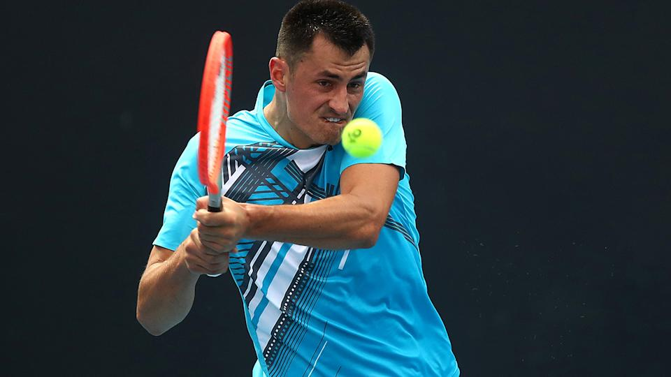 Bernard Tomic advanced to the second round after Yuichi Sugita retired hurt in the third set of their first-round match. (Photo by Mike Owen/Getty Images)