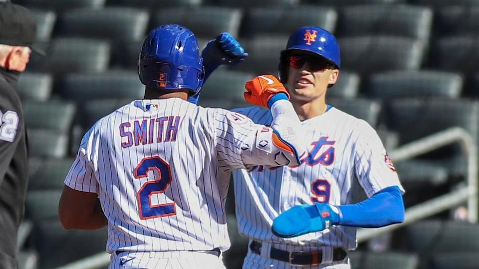 Apr 13, 2021; New York City, New York, USA; New York Mets center fielder Brandon Nimmo (9) congratulates left fielder Dominic Smith (2) after his two run home run in the first inning against the Philadelphia Phillies at Citi Field.