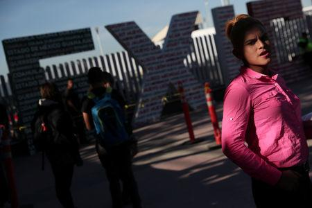 Evelyn Alexandra Salguero from Guatemala, part of a caravan of thousands from Central America tying to reach the United States, waits for her number in order to seek asylum at the Chaparral border crossing  in Tijuana, Mexico, January 25, 2019. REUTERS/Shannon Stapleton