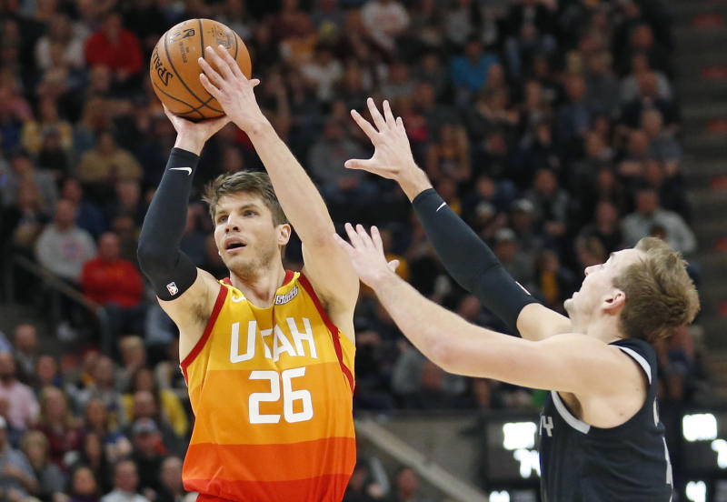 Detroit Pistons guard Luke Kennard, right, defends against Utah Jazz guard Kyle Korver (26) during the second half of an NBA basketball game Monday,Jan. 14 , 2019, in Salt Lake City. (AP Photo/Rick Bowmer)
