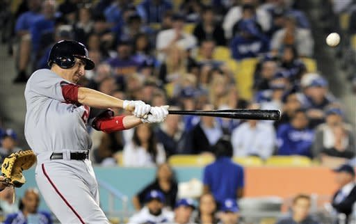 Washington Nationals first baseman Adam LaRoche hits a two-run home run during the sixth inning of their baseball game against the Los Angeles Dodgers, Friday, April 27, 2012, in Los Angeles. (AP Photo/Mark J. Terrill)