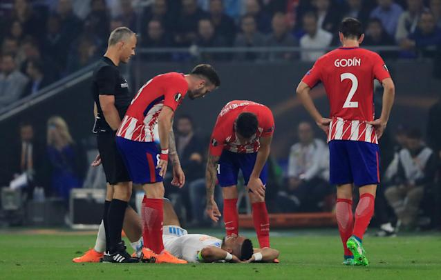 Soccer Football - Europa League Final - Olympique de Marseille vs Atletico Madrid - Groupama Stadium, Lyon, France - May 16, 2018 Marseille's Dimitri Payet is down after sustaining an injury and is later substituted off REUTERS/Gonzalo Fuentes