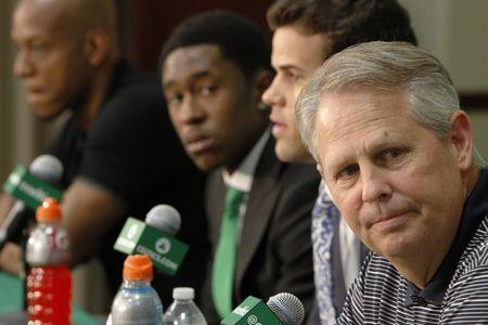 Boston Celtics President of Basketball Operations Danny Ainge (R) speaks during a news conference to introduce Keith Bogans (L), MarShon Brooks (2nd L), and Kris Humphries (2nd R) as Celtics players in Waltham, Massachusetts, July 15, 2013. The Celtics traded Kevin Garnett and Paul Pierce to the Brooklyn Nets in exchange for Gerald Wallace (not present), Humphries, Brooks and Bogans. REUTERS/Dominick Reuter (UNITED STATES - Tags: SPORT BASKETBALL)