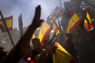 Protesters make the fascist salute as ultra right wing protesters march during an alternative celebration for Spain's National Day in Barcelona, Spain, Tuesday, Oct. 12, 2021. Spain commemorates Christopher Columbus' arrival in the New World and also Spain's armed forces day. (AP Photo/Emilio Morenatti)