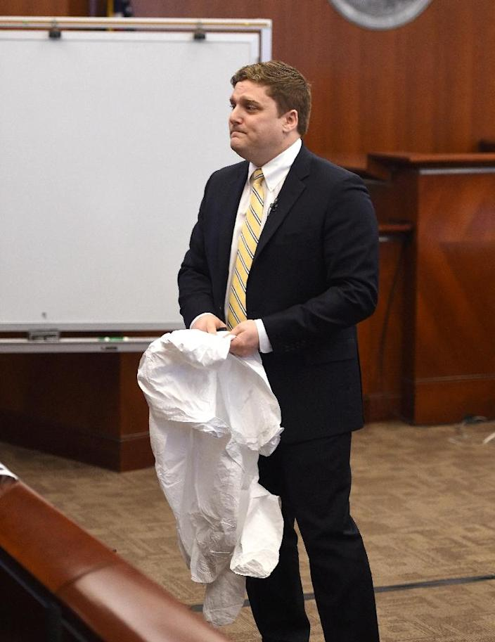 Attorney Brent Wisner displays a protective suit like the one worn by his client, the plaintiff Dewayne Johnson, who is suing Monsanto alleging its weed killer Roundup caused his cancer (AFP Photo/JOSH EDELSON)