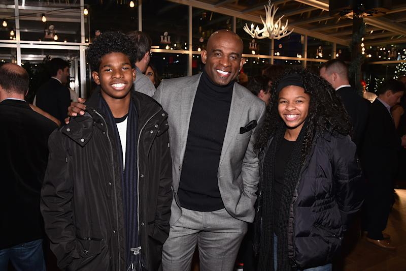 NEW YORK, NY - DECEMBER 14: (L-R) Shedeur Sanders, former football player Deion Sanders and Shelomi Sanders attend On Location Experiences' 51 Days To Super Bowl LI Celebration at STK Rooftop on December 14, 2016 in New York City. (Photo by Bryan Bedder/Getty Images for On Location Experiences)