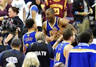 Jun 16, 2015; Cleveland, OH, USA; Golden State Warriors guard Andre Iguodala (9) and guard Stephen Curry (30) celebrate after game six of the NBA Finals against the Cleveland Cavaliers at Quicken Loans Arena. Warriors won 105-97. Mandatory Credit: David Richard-USA TODAY Sports