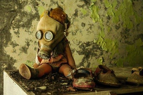 """<span class=""""caption"""">Chernobyl and COVID-19: when the threat is in the air you breathe. </span> <span class=""""attribution""""><a class=""""link rapid-noclick-resp"""" href=""""https://www.shutterstock.com/image-photo/chernobyl-ukraine-february-2016-doll-gas-1410706853"""" rel=""""nofollow noopener"""" target=""""_blank"""" data-ylk=""""slk:Ondrej Bucek/Shutterstock"""">Ondrej Bucek/Shutterstock</a></span>"""