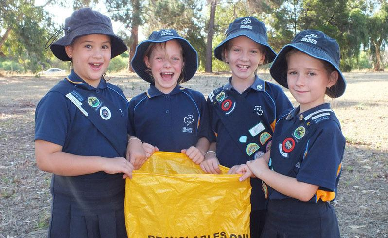 Guides set example with litter clean up