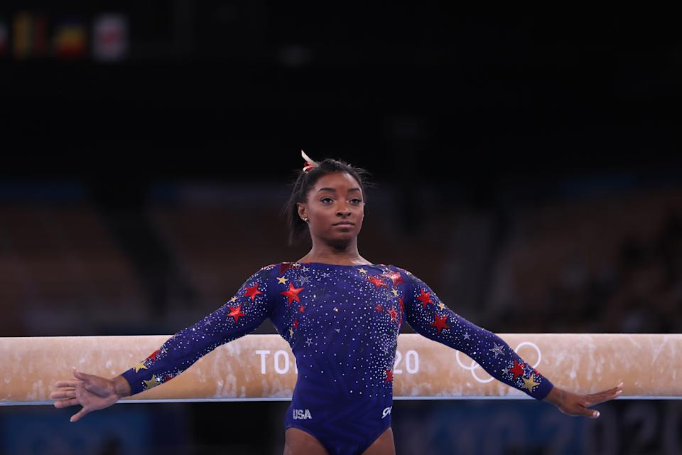 <p>TOKYO, JAPAN - JULY 25: Simone Biles of Team United States competes on balance beam on day two of the Tokyo 2020 Olympic Games at Ariake Gymnastics Centre on July 25, 2021 in Tokyo, Japan. (Photo by Amin Mohammad Jamali/Getty Images)</p>