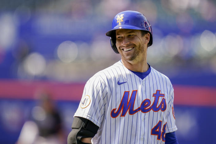 New York Mets' Jacob deGrom reacts after hitting an infield single off Miami Marlins starting pitcher Trevor Rogers in the sixth inning of a baseball game, Saturday, April 10, 2021, in New York. (AP Photo/John Minchillo)
