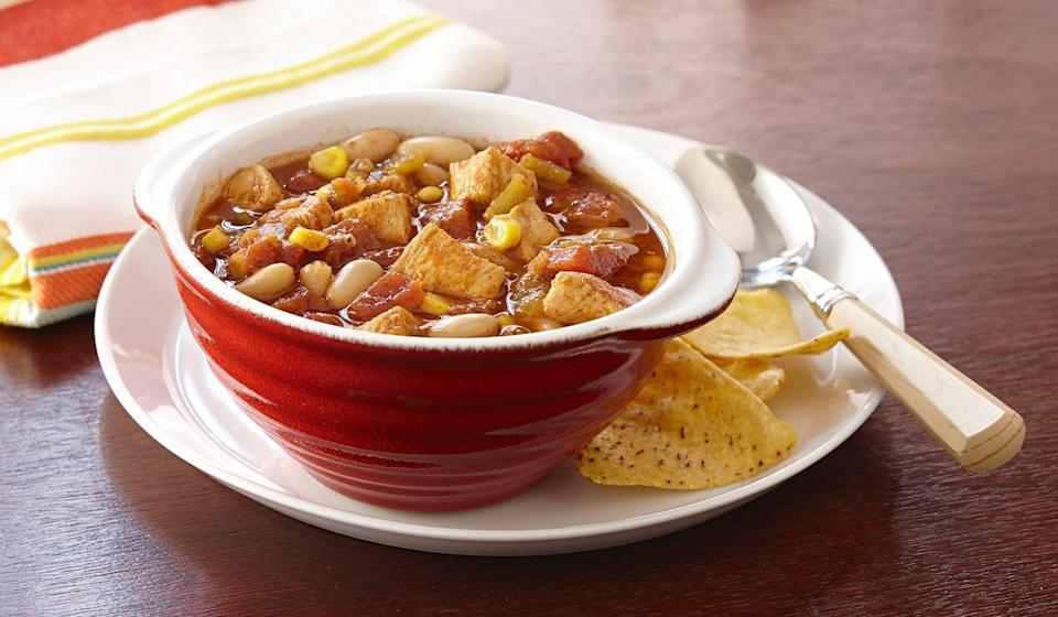 """<p>With just 10 minutes of preparation, you can have this chili recipe on your dinner table. One of the best <a href=""""https://www.thedailymeal.com/cook/slow-cooker-chicken-recipes-gallery?referrer=yahoo&category=beauty_food&include_utm=1&utm_medium=referral&utm_source=yahoo&utm_campaign=feed"""" rel=""""nofollow noopener"""" target=""""_blank"""" data-ylk=""""slk:slow cooker chicken recipes"""" class=""""link rapid-noclick-resp"""">slow cooker chicken recipes</a>, it's filled with proteins and the <a href=""""https://www.thedailymeal.com/cook/heres-your-guide-every-type-bean-and-best-recipes-them-0?referrer=yahoo&category=beauty_food&include_utm=1&utm_medium=referral&utm_source=yahoo&utm_campaign=feed"""" rel=""""nofollow noopener"""" target=""""_blank"""" data-ylk=""""slk:beans cook"""" class=""""link rapid-noclick-resp"""">beans cook</a> beautifully in the <a href=""""https://bestreviews.com/best-slow-cookers?referrer=yahoo&category=beauty_food&include_utm=1&utm_medium=referral&utm_source=yahoo&utm_campaign=feed"""" rel=""""nofollow noopener"""" target=""""_blank"""" data-ylk=""""slk:slow cooker"""" class=""""link rapid-noclick-resp"""">slow cooker</a>.</p> <p><a href=""""https://www.thedailymeal.com/recipes/slow-cooker-chicken-bean-chili?referrer=yahoo&category=beauty_food&include_utm=1&utm_medium=referral&utm_source=yahoo&utm_campaign=feed"""" rel=""""nofollow noopener"""" target=""""_blank"""" data-ylk=""""slk:For the Slow Cooker Chicken and Bean Chili recipe, click here"""" class=""""link rapid-noclick-resp"""">For the Slow Cooker Chicken and Bean Chili recipe, click here</a>.</p>"""