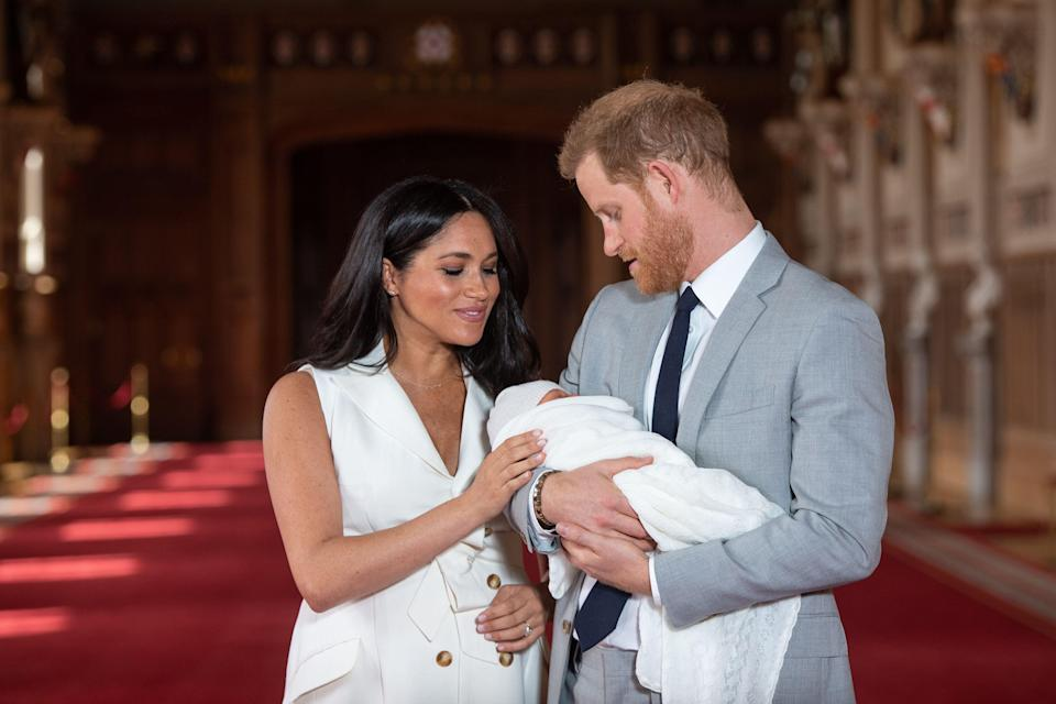 Meghan and Harry with their baby son Archie at Windsor Castle [Photo: PA]