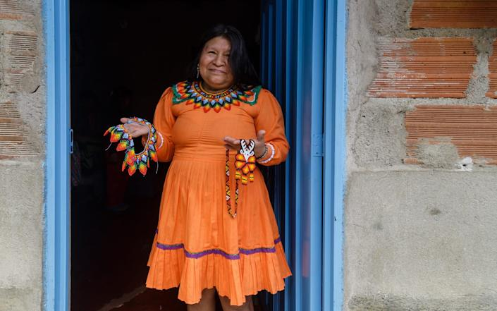 María Orfilia, who makes traditional jewellery using designs that she learnt from her community the Emberá Chamí, has been unable to sell her handmade necklaces since national quarantine was imposed on March 20 - Jorge Calle