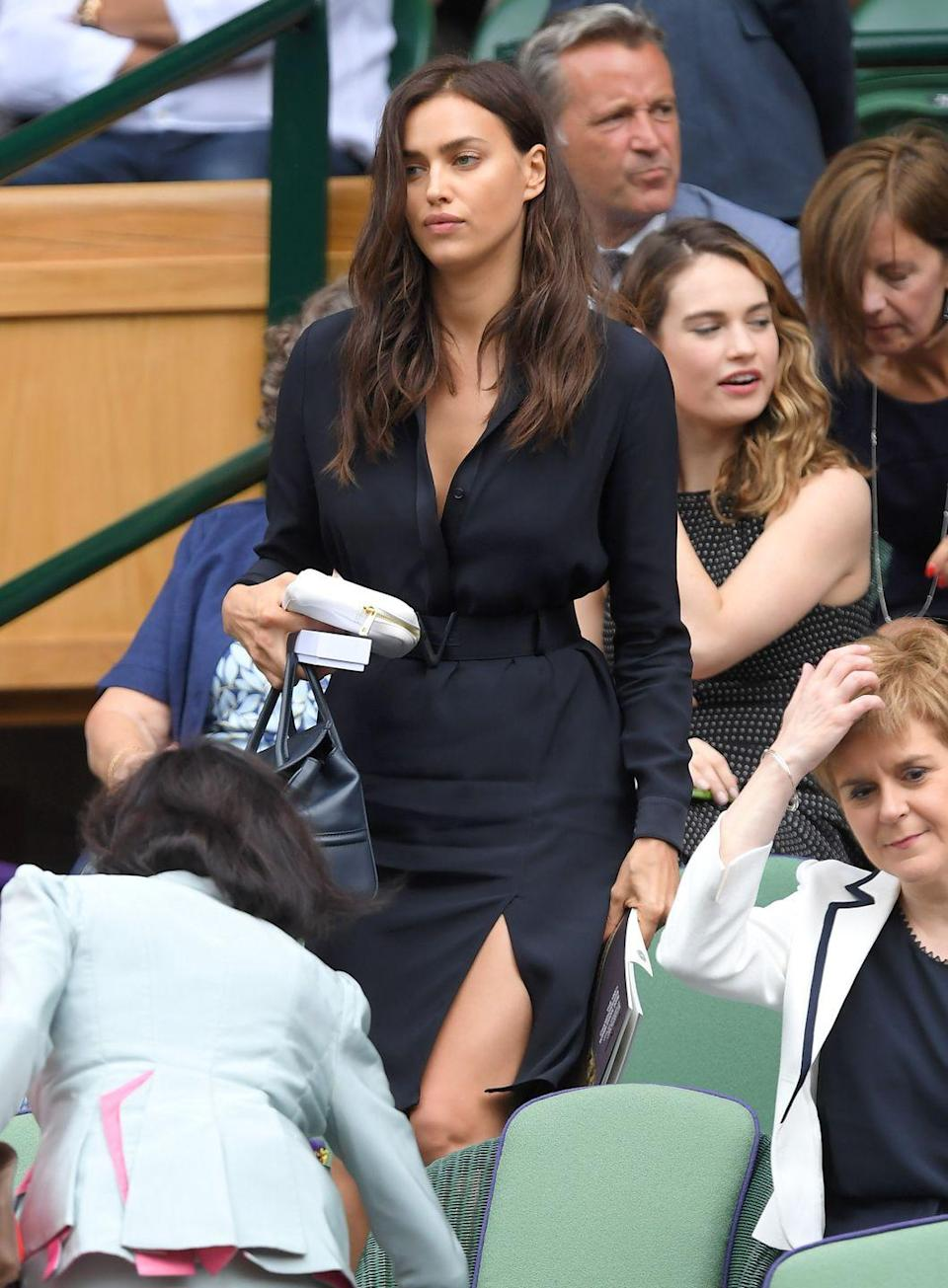 <p><strong>2016</strong> The model also attended the men's final that year, and kept things simple in a navy shirt dress.</p>
