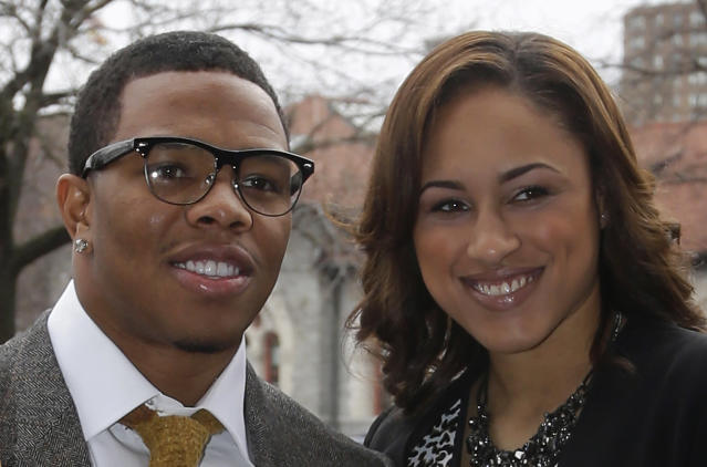 In this March 11, 2013, photo, Baltimore Ravens running back Ray Rice, left, poses with his fiancee, Janay Palmer, in Baltimore as they arrive for a screening of a new film that chronicles the team's championship NFL football season. Rice has been indicted on a charge he assaulted Palmer during an argument in an elevator at an Atlantic City, N.J., casino last month. Rice had been charged with simple assault after police said he knocked out Palmer on Feb. 15. But a grand jury Thursday, March 27, 2014, indicted him on a more serious count of aggravated assault, which carries a three-to-five-year sentence. (AP Photo/Patrick Semansky)