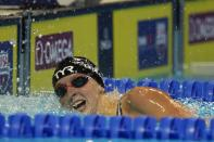 Katie Ledecky reacts after winning in the women's 200 freestyle during wave 2 of the U.S. Olympic Swim Trials on Wednesday, June 16, 2021, in Omaha, Neb. (AP Photo/Jeff Roberson)
