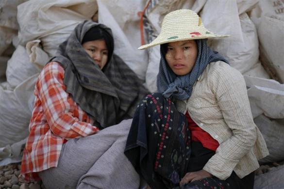 Workers rest at a construction site in capital Naypyitaw, January 24, 2012.