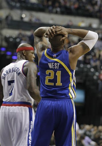 Indiana Pacers' David West, right, reacts after committing a turnover while being defended by Denver Nuggets' Al Harrington, left, during the second half of an NBA basketball game on Saturday, Feb. 11, 2012, in Indianapolis. Denver won 113-109. (AP Photo/Darron Cummings)