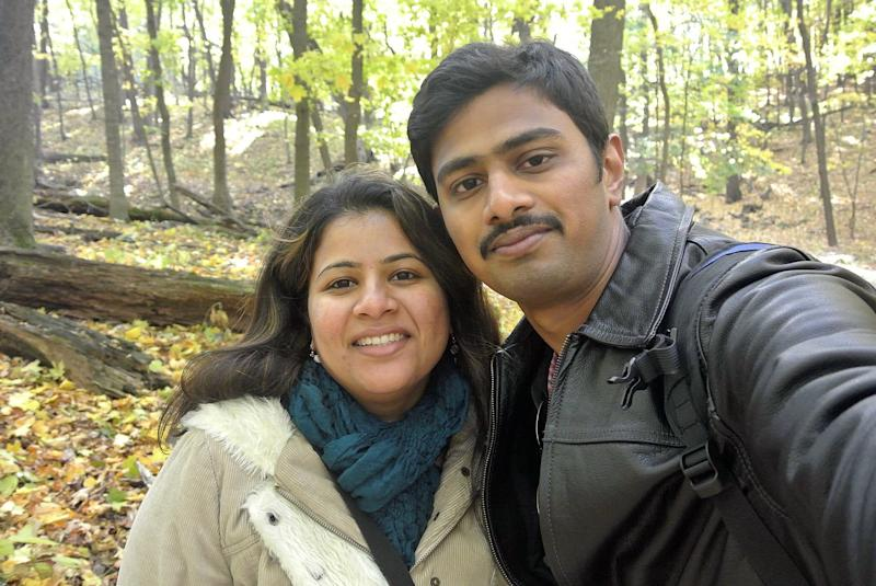"""In this undated photo provided by Kranti Shalia, Srinivas Kuchibhotla, right, poses for photo with his wife Sunayana Dumala in Cedar Rapids, Iowa. In the middle of a crowded bar, a 51-year-old former air traffic controller yelled at two Indian men - Kuchibhotla and Alok Madasani - to """"get out of my country,"""" witnesses said, then opened fire in an attack that killed one of the men and wounded the other, as well as a third man who tried to help, Thursday, Feb 23, 2017, in Olathe, Kan. (Kranti Shalia via AP)"""