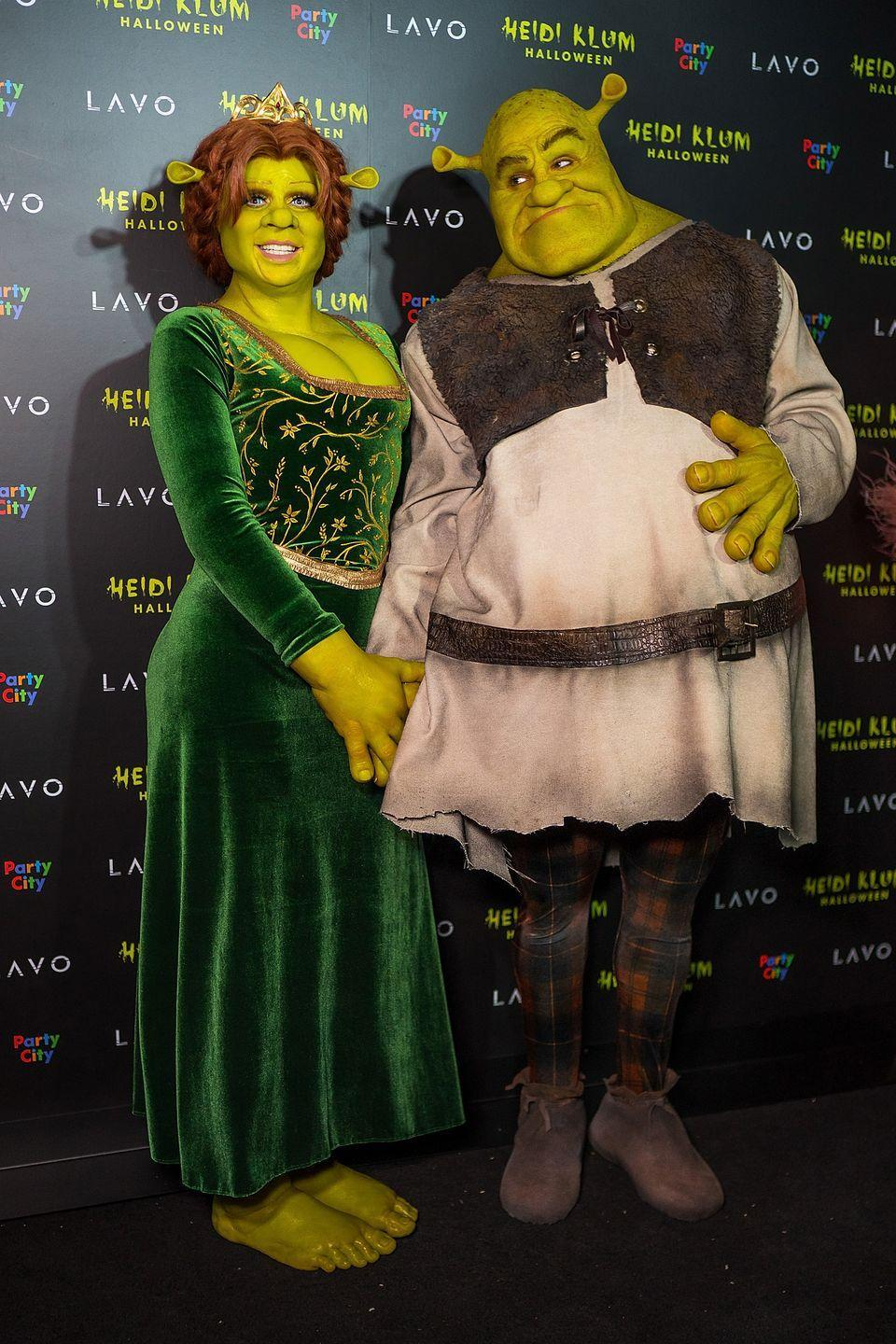 "<p>Heidi Klum is known for her <a href=""https://www.marieclaire.com/celebrity/g4151/heidi-klum-halloween-costumes/"" rel=""nofollow noopener"" target=""_blank"" data-ylk=""slk:remarkable costumes"" class=""link rapid-noclick-resp"">remarkable costumes</a>, but even this one took things to the next level. The model and her husband Tom Kaulitz were unrecognizable in 2018 as the <em>Shrek </em>characters.</p>"