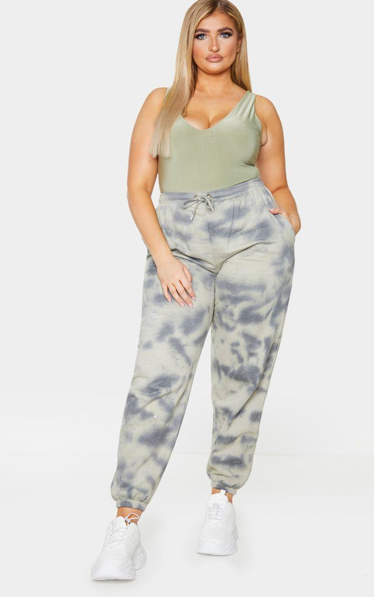 "Acid wash and sage green are huge trends right now, and this pair of sweats from PrettyLittleThing strikes the perfect balance. Pair this with an oversized T-shirt when you're lounging at home, or pre-plan your first post-quarantine outing by dressing it up with heels and a bodysuit. $38, PrettyLittleThing. <a href=""https://www.prettylittlething.us/plus-sage-acid-wash-joggers.html"" rel=""nofollow noopener"" target=""_blank"" data-ylk=""slk:Get it now!"" class=""link rapid-noclick-resp"">Get it now!</a>"