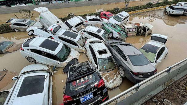 PHOTO: Cars sit in floodwaters after heavy rains hit the city of Zhengzhou in China, July 21, 2021. (AFP via Getty Images)