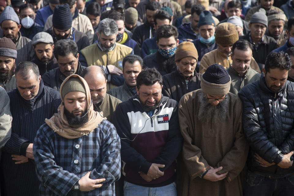 An unidentified relative of Basharat Ahmad Zargar weeps during his funeral in Srinagar, Indian-controlled Kashmir, Sunday, Feb.14, 2021. Zargar, who was working at a power project, was among the dozens killed after a part of a Himalayan glacier broke off on February 7 sending a devastating flood downriver slamming into two hydropower projects in northern India. (AP Photo/Mukhtar Khan)