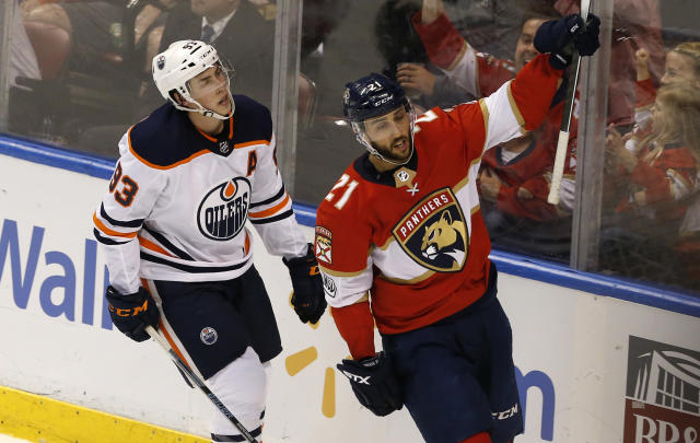 Florida Panthers center Vincent Trocheck (21) celebrates his second period goal in front Edmonton Oilers center Ryan Nugent-Hopkins (93) during an NHL hockey game, Saturday, March 17, 2018, in Sunrise, Fla. (AP Photo/Joe Skipper)