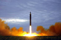 FILE - This Aug. 29, 2017, file photo provided by the North Korean government shows what was said to be the test launch of a Hwasong-12 intermediate range missile in Pyongyang, North Korea. Last year was a disaster for North Korean leader Kim Jong Un, who helplessly watched his country's economy decay amid pandemic border closures while brooding over the collapse of made-for-TV summits with former President Donald Trump that failed to lift sanctions from his country. Now he must start over with President Joe Biden, who has previously called him a thug and accused Trump of chasing spectacles instead of meaningful reductions of Kim's nuclear arsenal. (Korean Central News Agency/Korea News Service via AP, File)