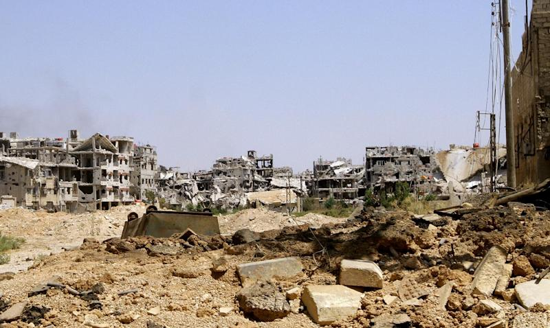 Damaged buildings in Mleiha, on the outskirts of Damascus, August 15, 2014