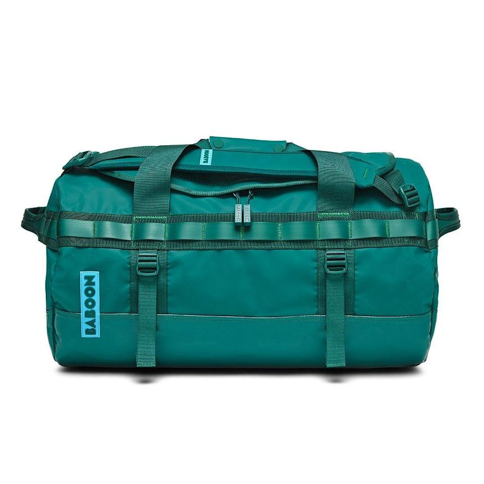 """<h2>Baboon Small Go-Bag</h2><br><strong>The Type: </strong>Small duffel<br><br><strong>The Hype:</strong> 4.9 out of 5 stars and 1,465 reviews at Baboon<br><br><strong>What Travelers Say: </strong>""""I love this bag, the straps are adjustable in more than a few ways, it's spacious, and has just the right amount of pockets. It is very obviously high quality and durable just by feeling it. Can't wait to travel with it!"""" – <em>Gabrielle C., Baboon Reviewer<br></em><br><em>Shop</em> <strong><em><a href=""""https://baboontothemoon.com/"""" rel=""""nofollow noopener"""" target=""""_blank"""" data-ylk=""""slk:Baboon"""" class=""""link rapid-noclick-resp"""">Baboon</a></em></strong><br><br><strong>Baboon</strong> Go-Bag — Small (40L), $, available at <a href=""""https://go.skimresources.com/?id=30283X879131&url=https%3A%2F%2Fbaboontothemoon.com%2Fproducts%2Fgo-bag-small-duffle%23variant%3Dblack-black"""" rel=""""nofollow noopener"""" target=""""_blank"""" data-ylk=""""slk:Baboon"""" class=""""link rapid-noclick-resp"""">Baboon</a>"""